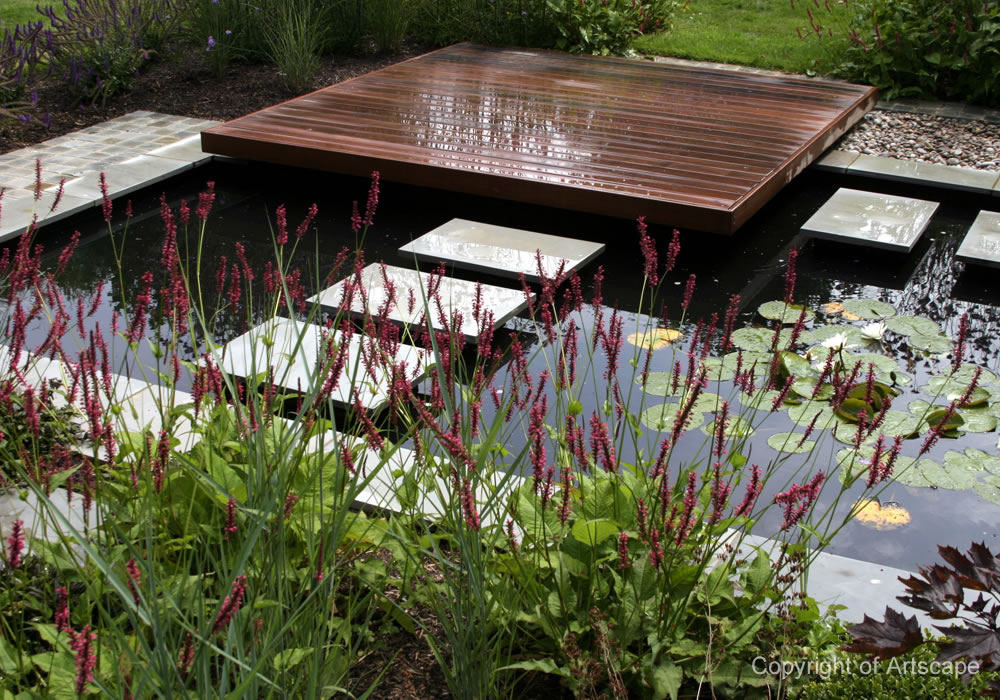 contemporary garden with wood store pond - Garden Examples Photos